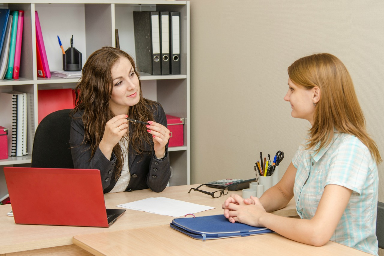 woman speaking with female client