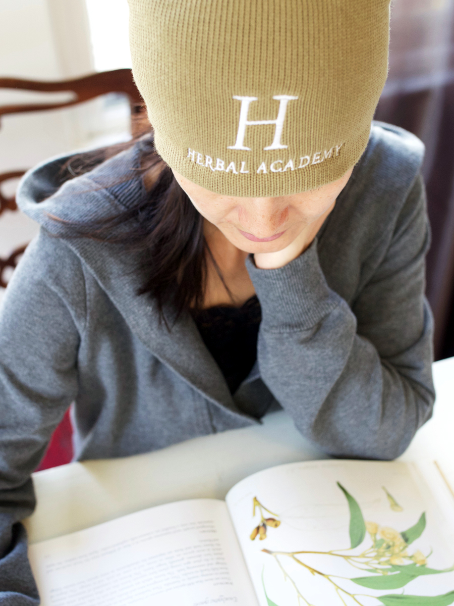 Unisex Organic Logo Cotton Beanie by Herbal Academy. Colors in Jungle and Charcoal.