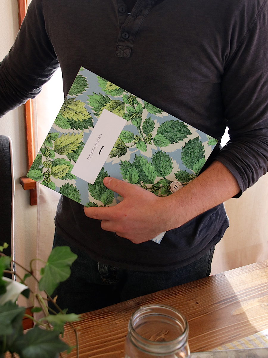 Herbal Academy Materia Medica Journal - journal in hand