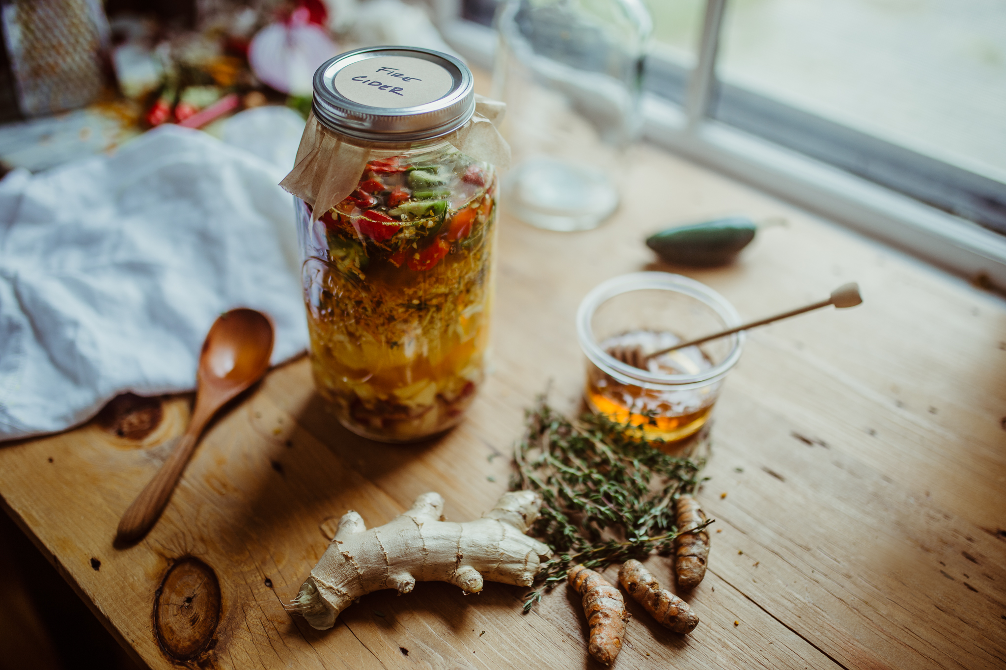 How To Make Homemade Fire Cider | Herbal Academy | 'Tis the season to make homemade fire cider! A shot glass of this a day is a great defense against colds and flu, and it also acts as a decongestant!