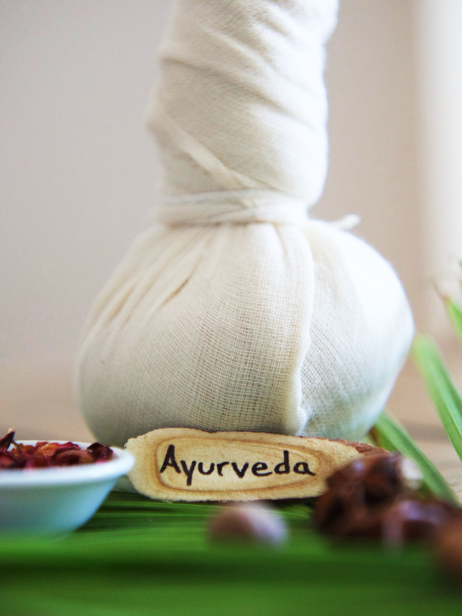 ayurveda towel with dried herbs on table