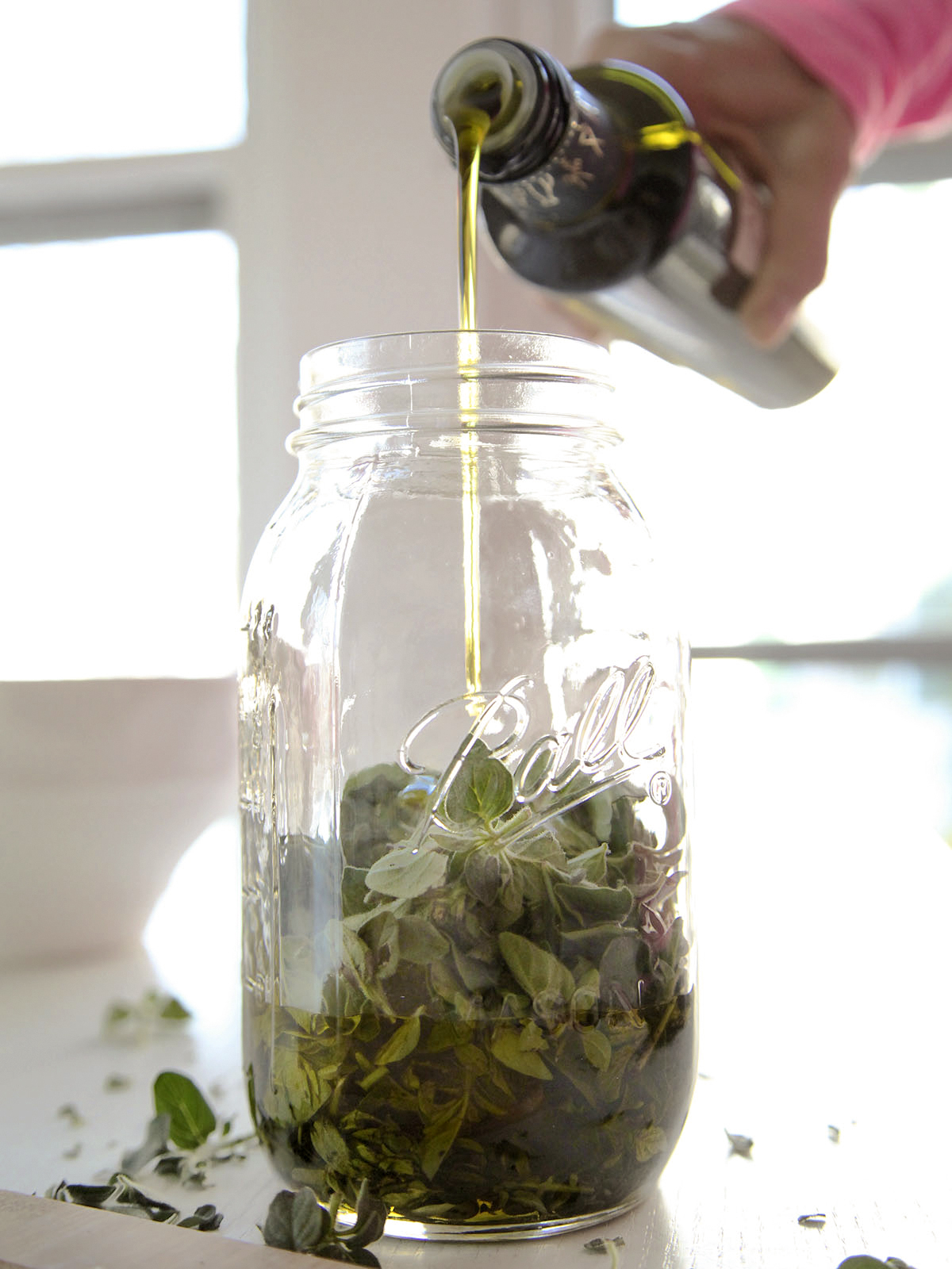 How To Make Herb-Infused Oils | Herbal Academy | There are many methods of infusing oil with herbs. In this article, we will demonstrate how to make herb-infused oils using these various methods.