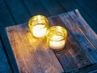DIY Natural Citronella Candles | Herbal Academy | Learn how to make citronella candles from beeswax, essential oils, and dried herbs to repel mosquitoes, flies, and other insects.