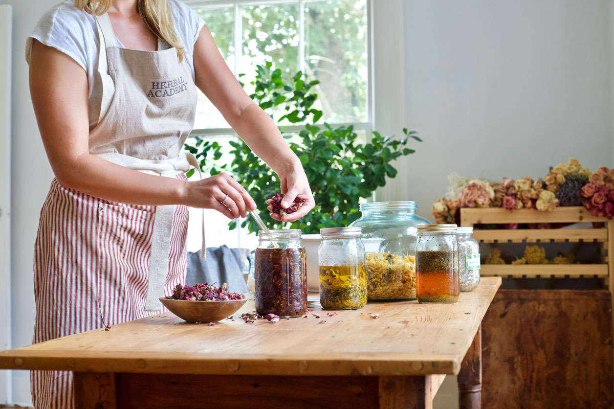 How to Make Alcohol Intermediary Herb-Infused Oils | Herbal Academy | With alcohol intermediary herb-infused oils you can save time, increase the shelf life of your oils, and create a stronger finished oil.