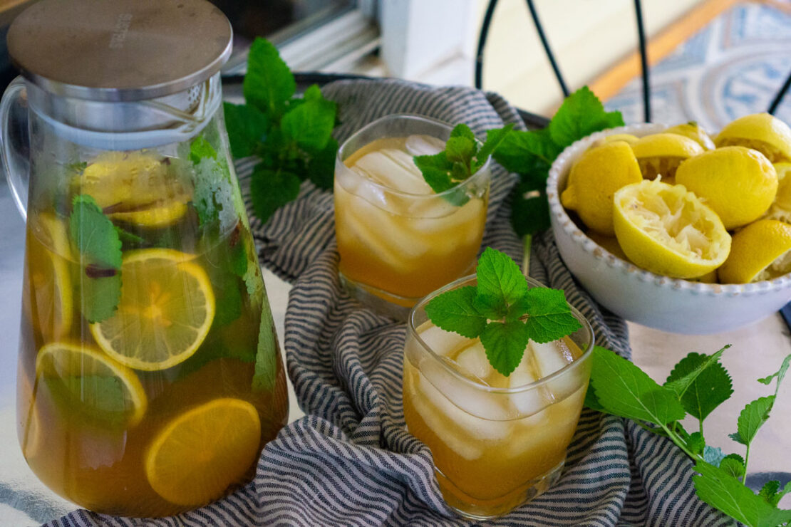 Herbal Arnold Palmer Recipe: Just What You Need!| Herbal Academy | Give a botanical twist to a classic drink with this healthy Herbal Arnold Palmer recipe featuring lemon balm, cloves, and mint.