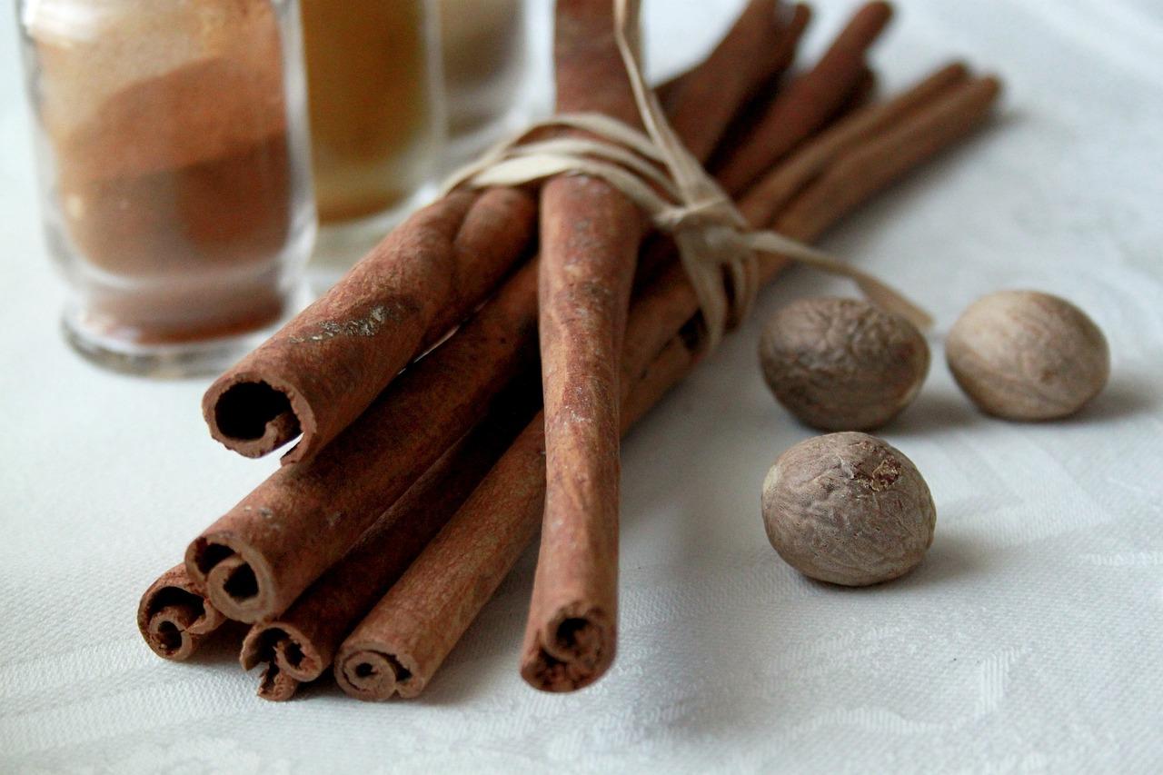 nutmeg and cinnamon on table