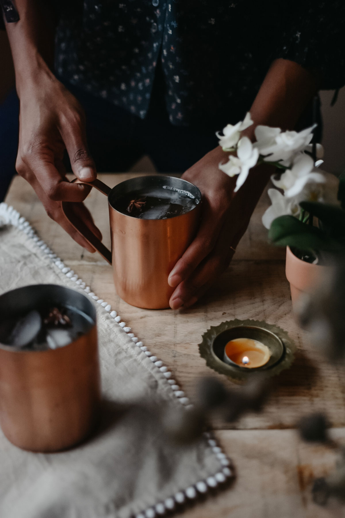 Chai spiced cider in copper mugs