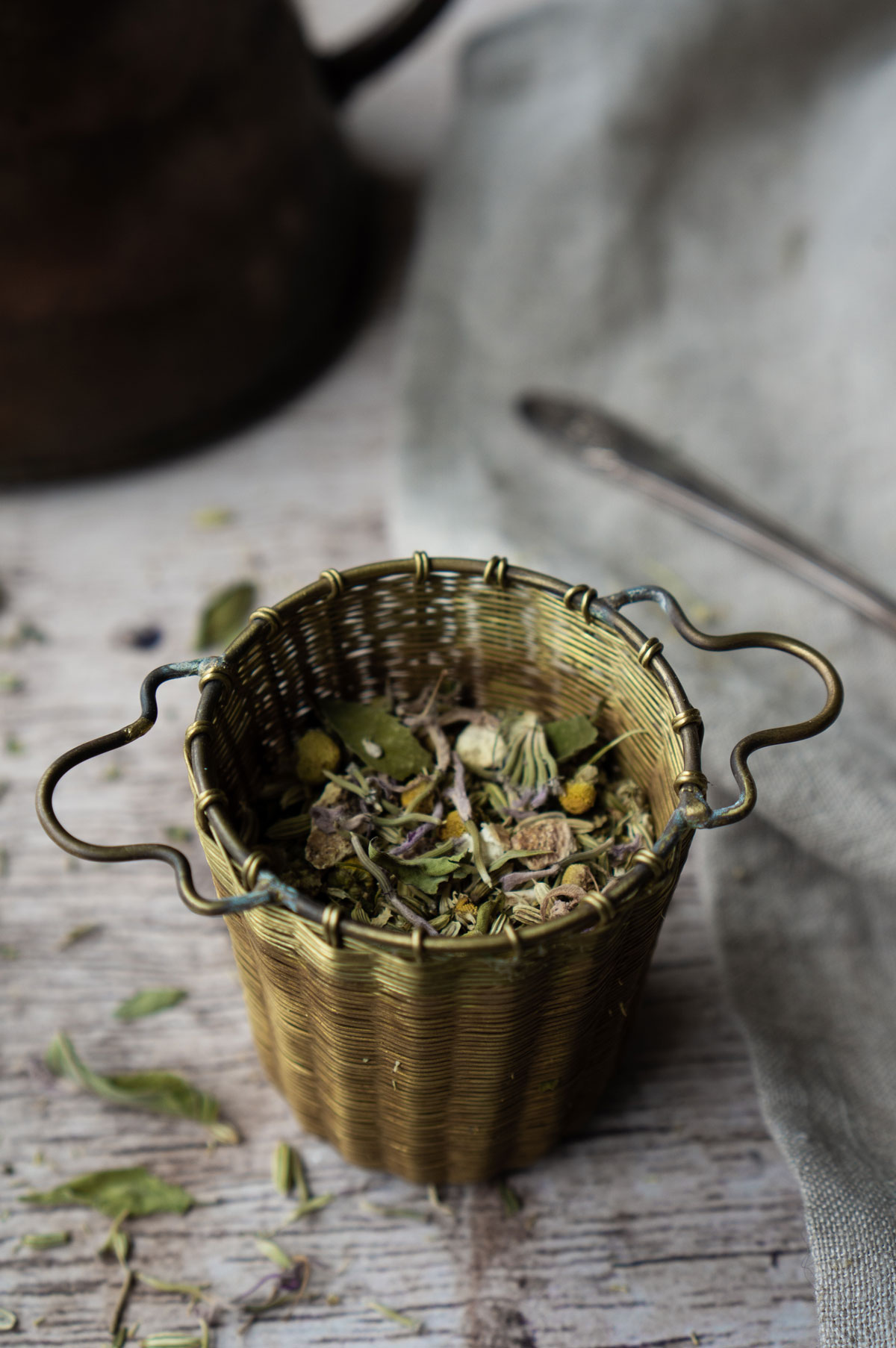 After-Dinner Fennel Tea in a brass tea strainer