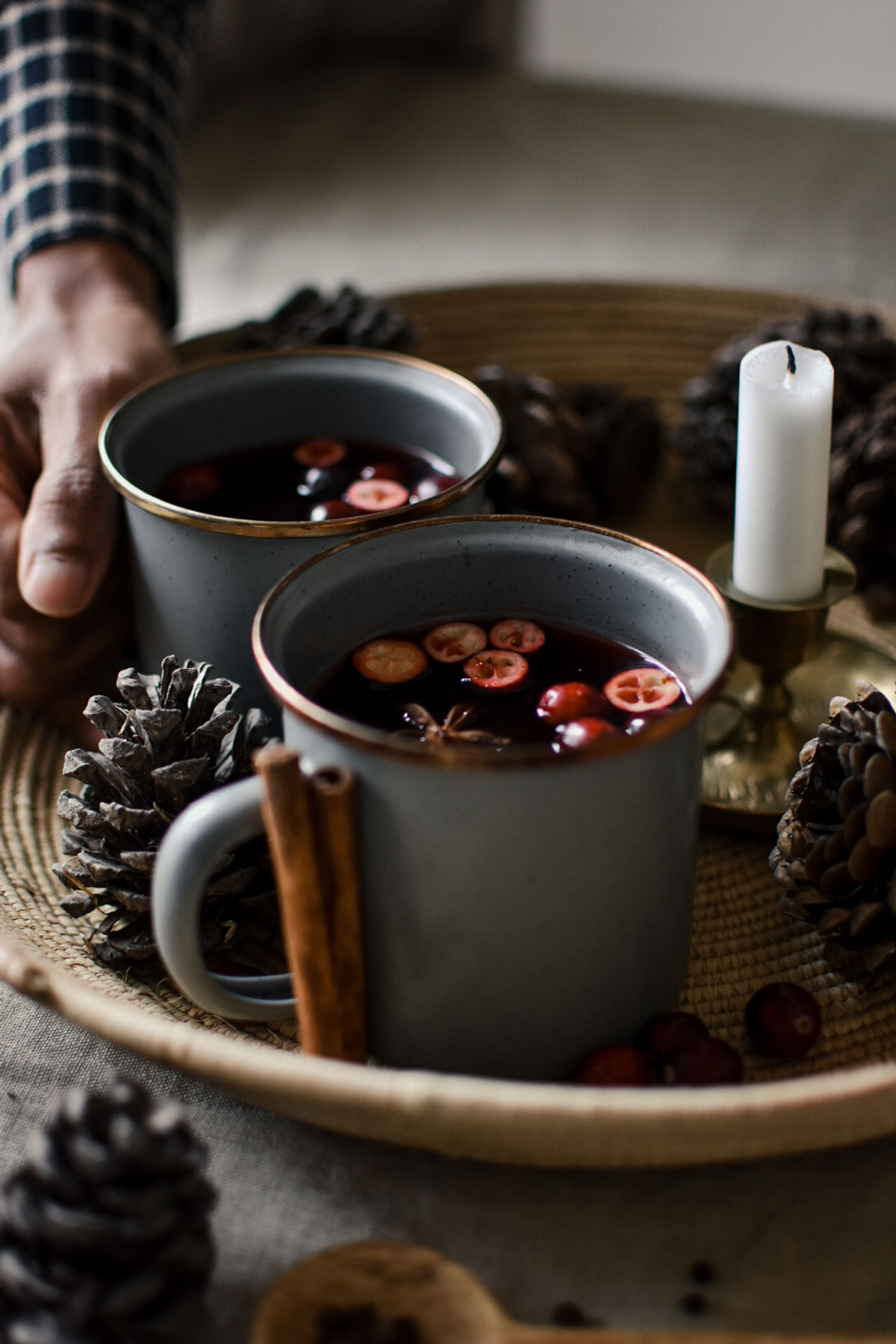 cranberry hot toddies in white mugs