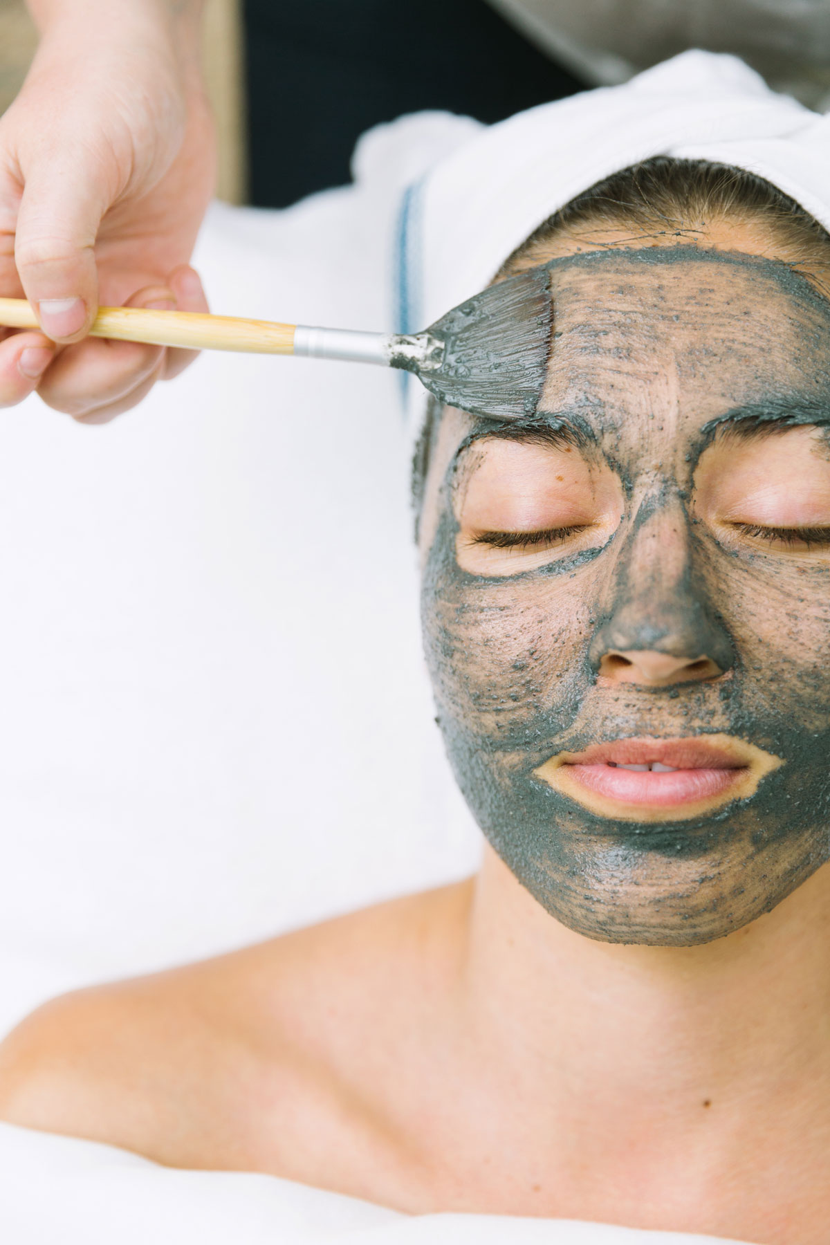 A woman receiving a skincare treatment at Ritual Skincare with Katie Woods