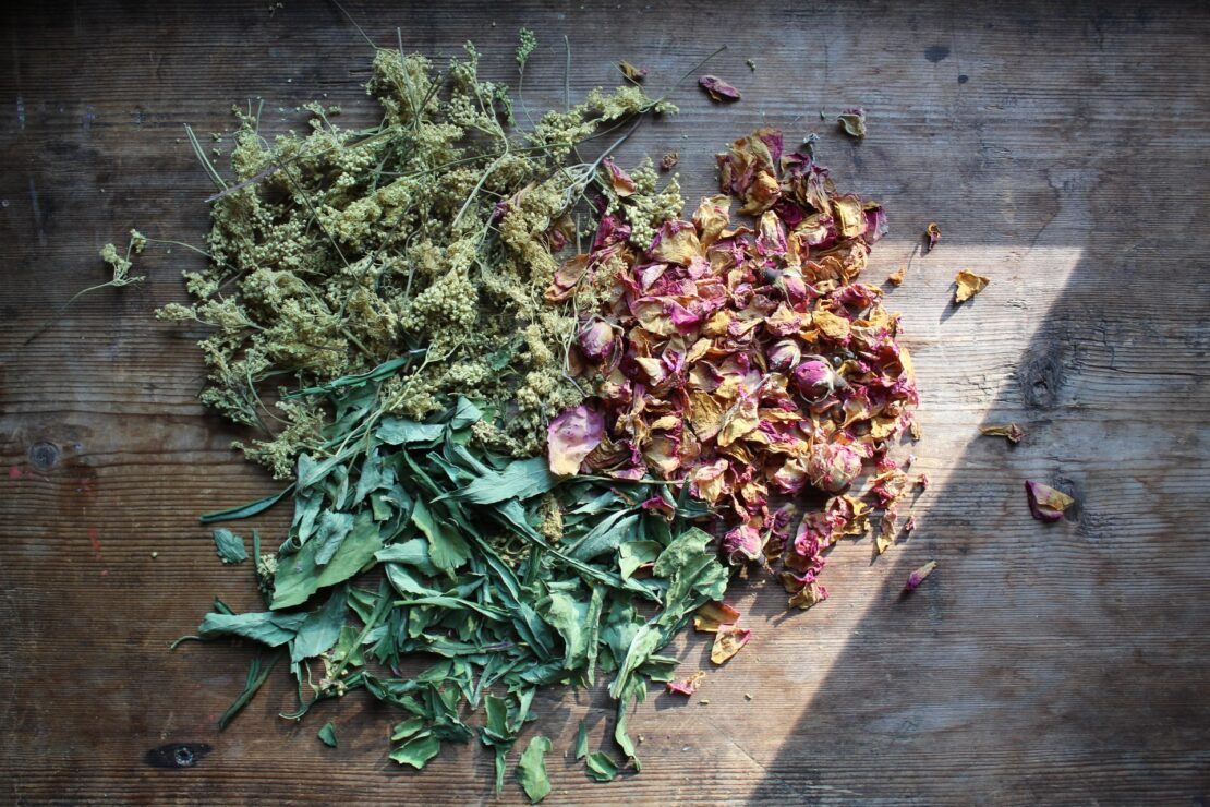 Meadowsweet Tea with Rose | Herbal Academy | dried herbs on wood board