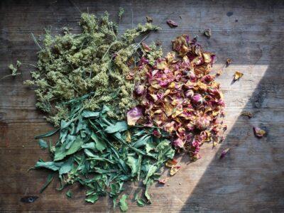 Meadowsweet Tea with Rose | Herbal Academy | dried herbs on wood board