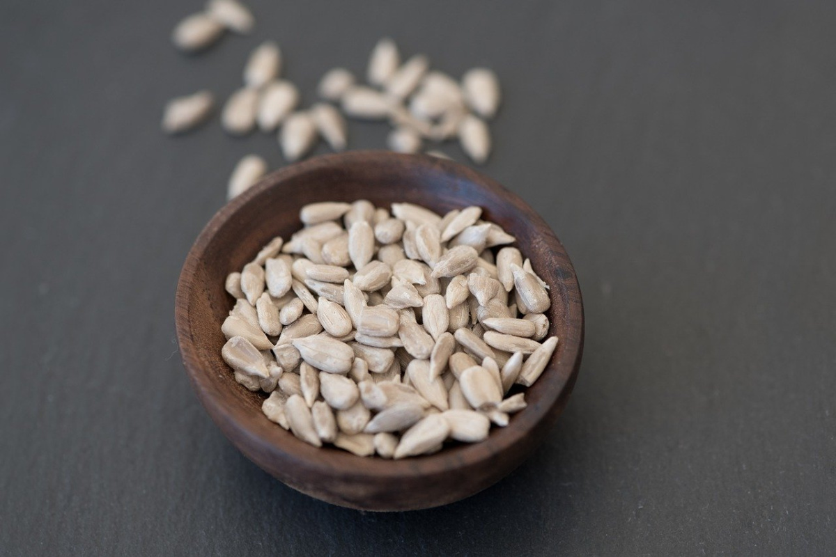 sunflower seeds in a brown bowl