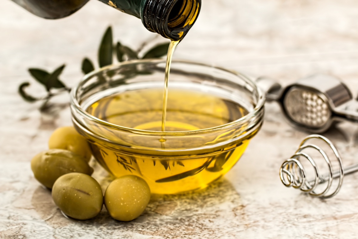 olives, olive oil, and herbs ready for traditional Mediterranean recipes