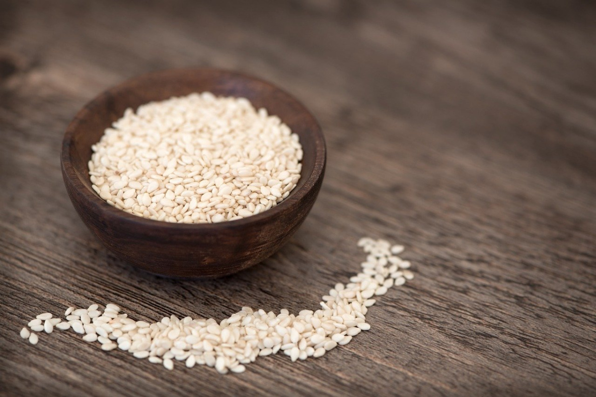 sesame seeds in a wooden bowl for nourishing herbs