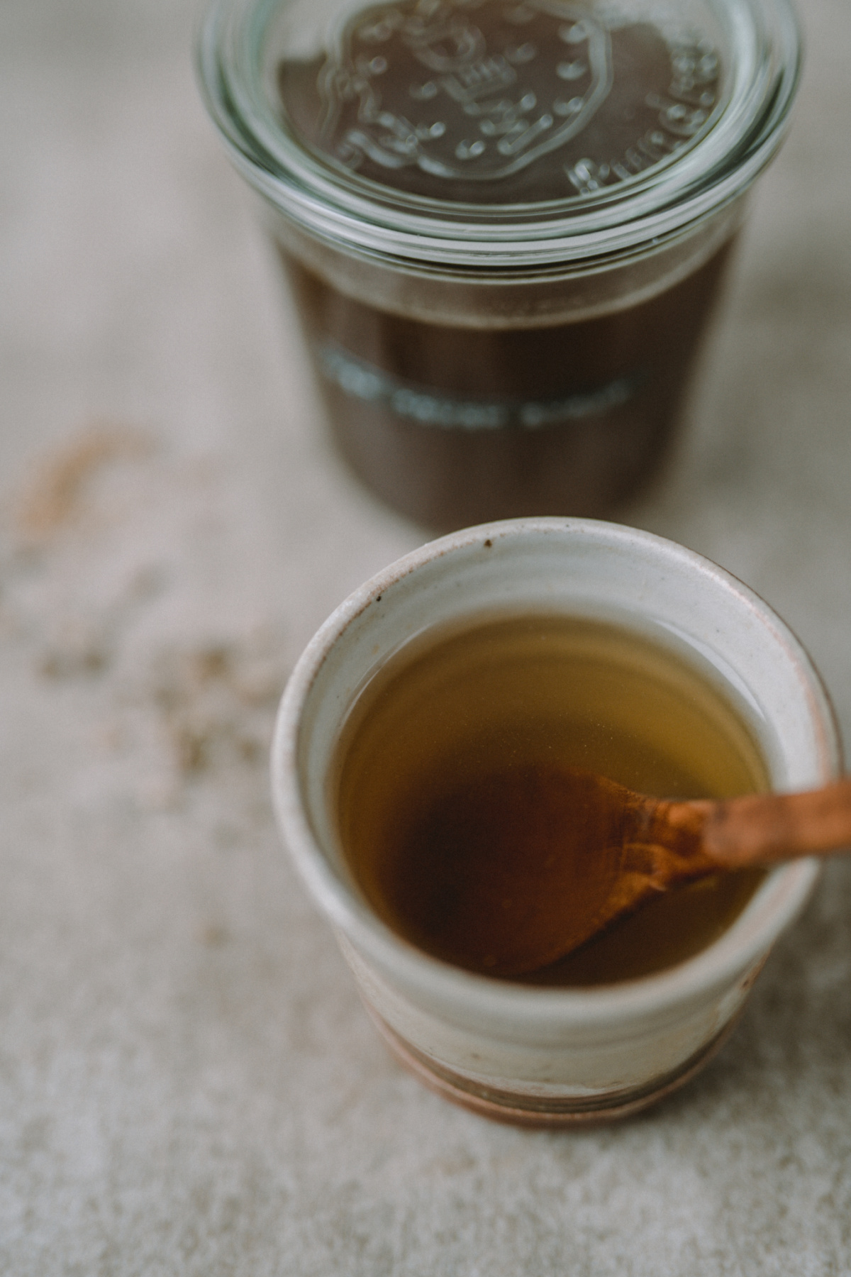 cup of tea with homemade cough syrup