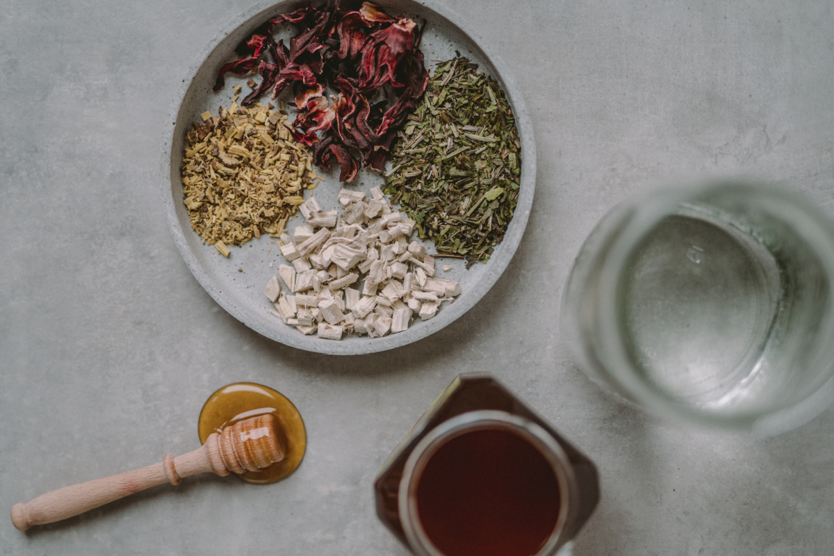 dried herbs and honey ready for dry cough syrup recipe