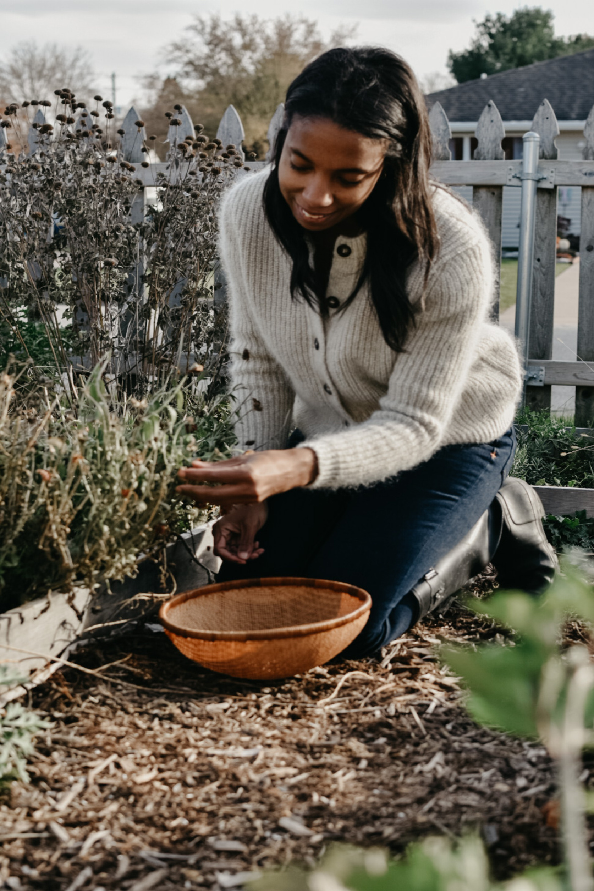 herbalist connecting with an herb in her garden