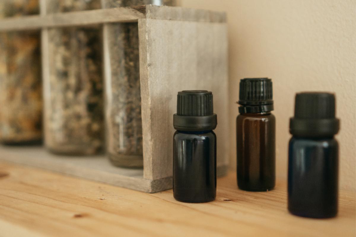 essential oil bottles on a shelf
