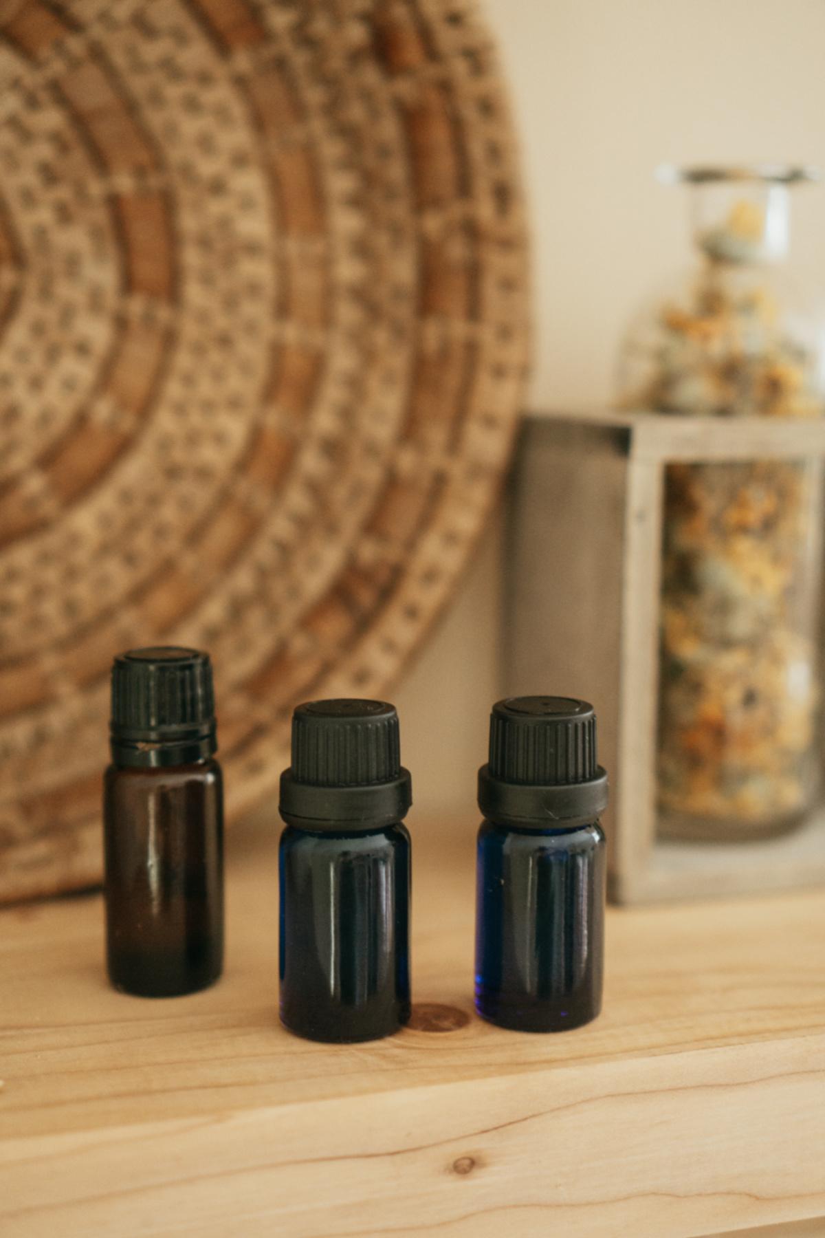 essential oil bottles next to a wicker basket