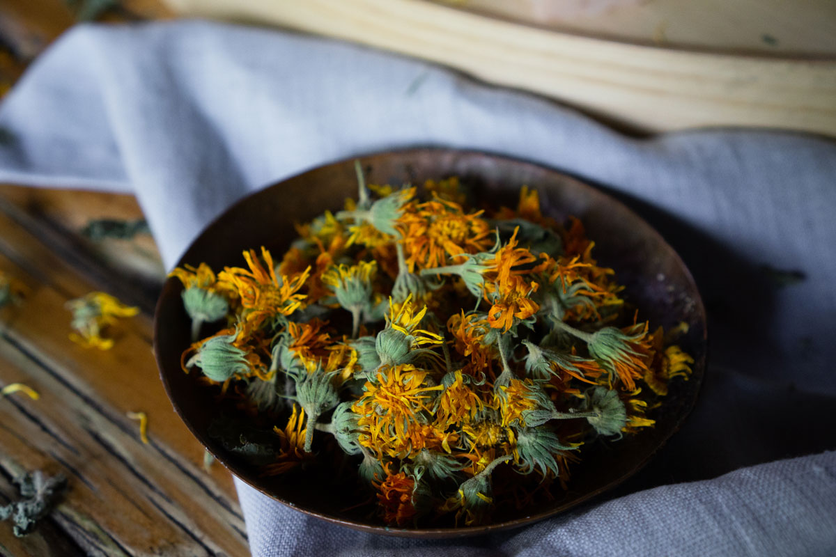 calendula flowers on a rustic pan