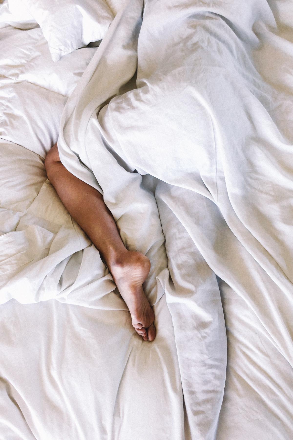 woman sleeping under covers