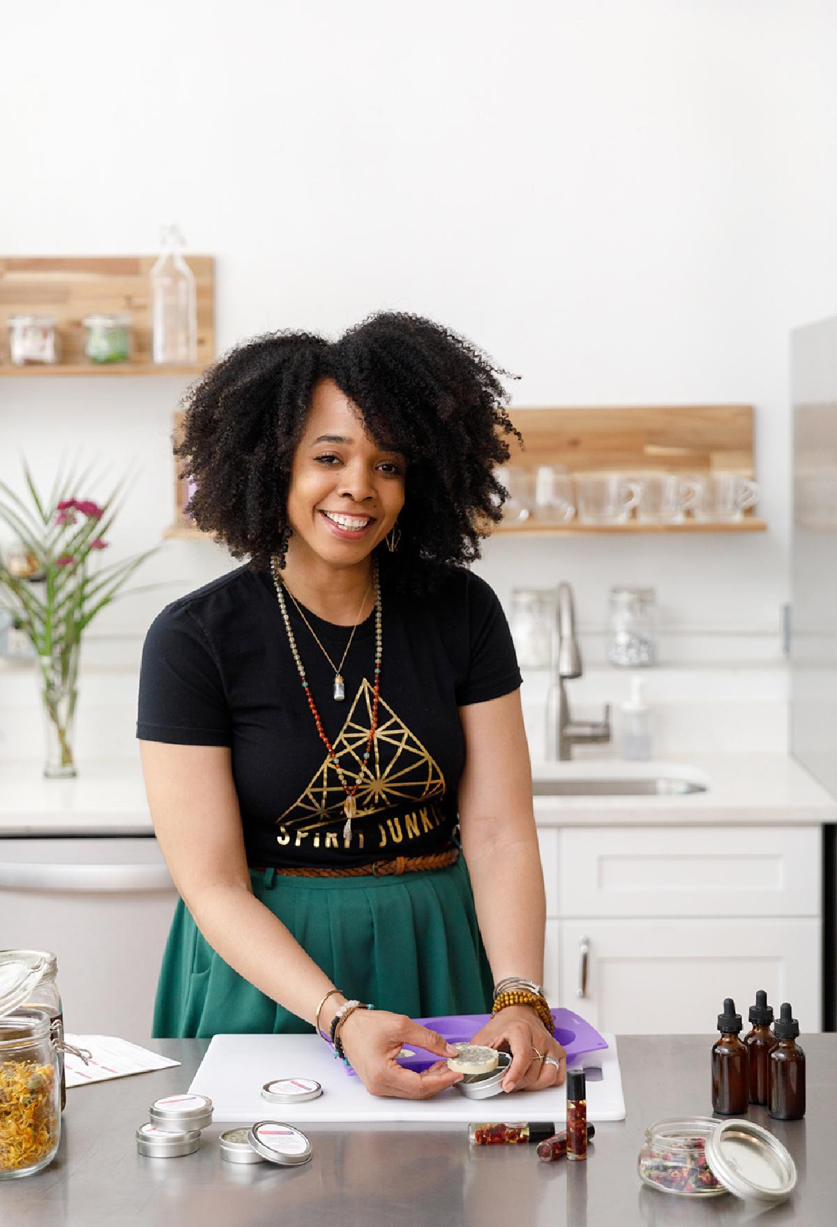 Kendra Payne making herbal preparations in her herb store