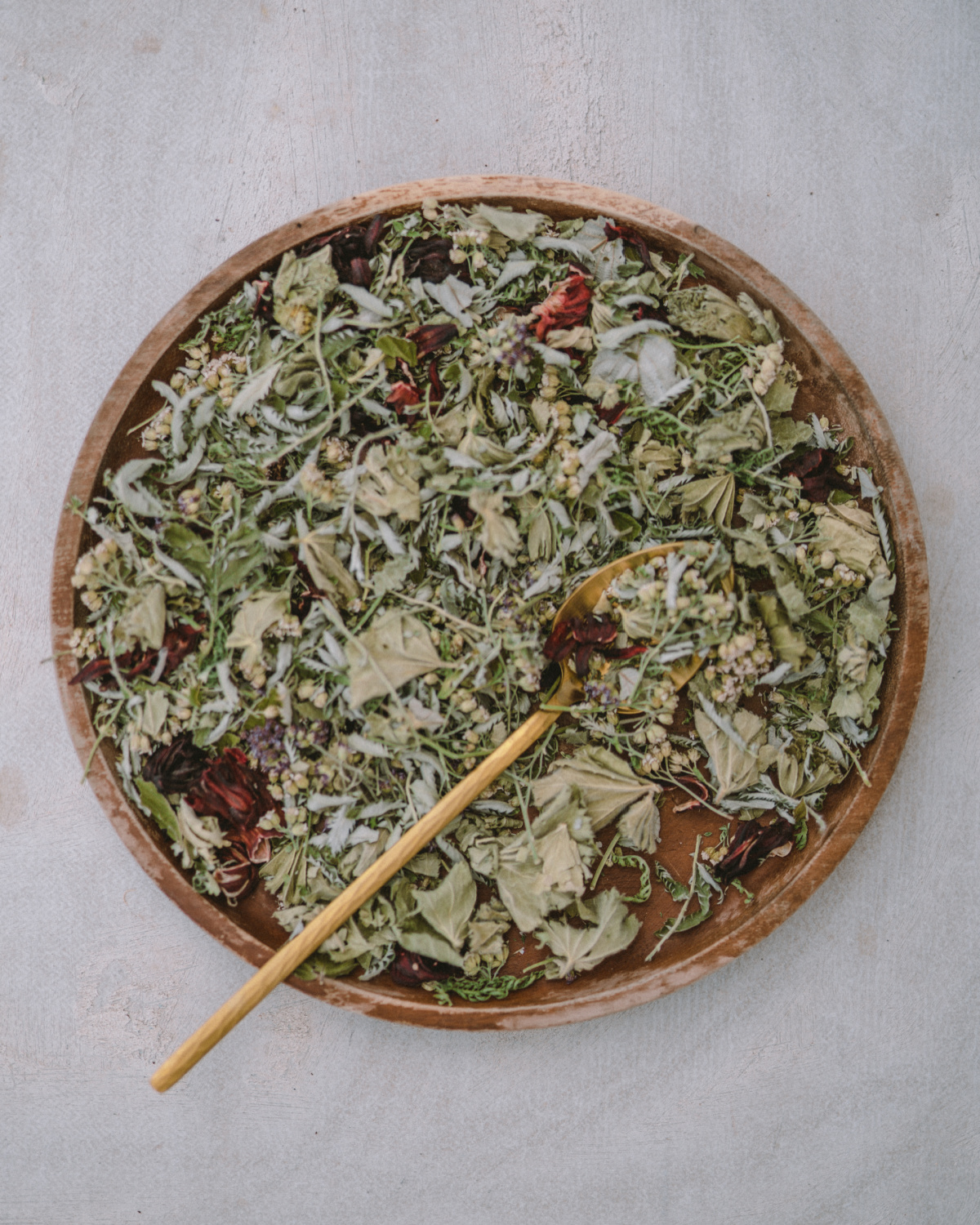 dried herbs in a wooden bowl ready to make Moon Tea