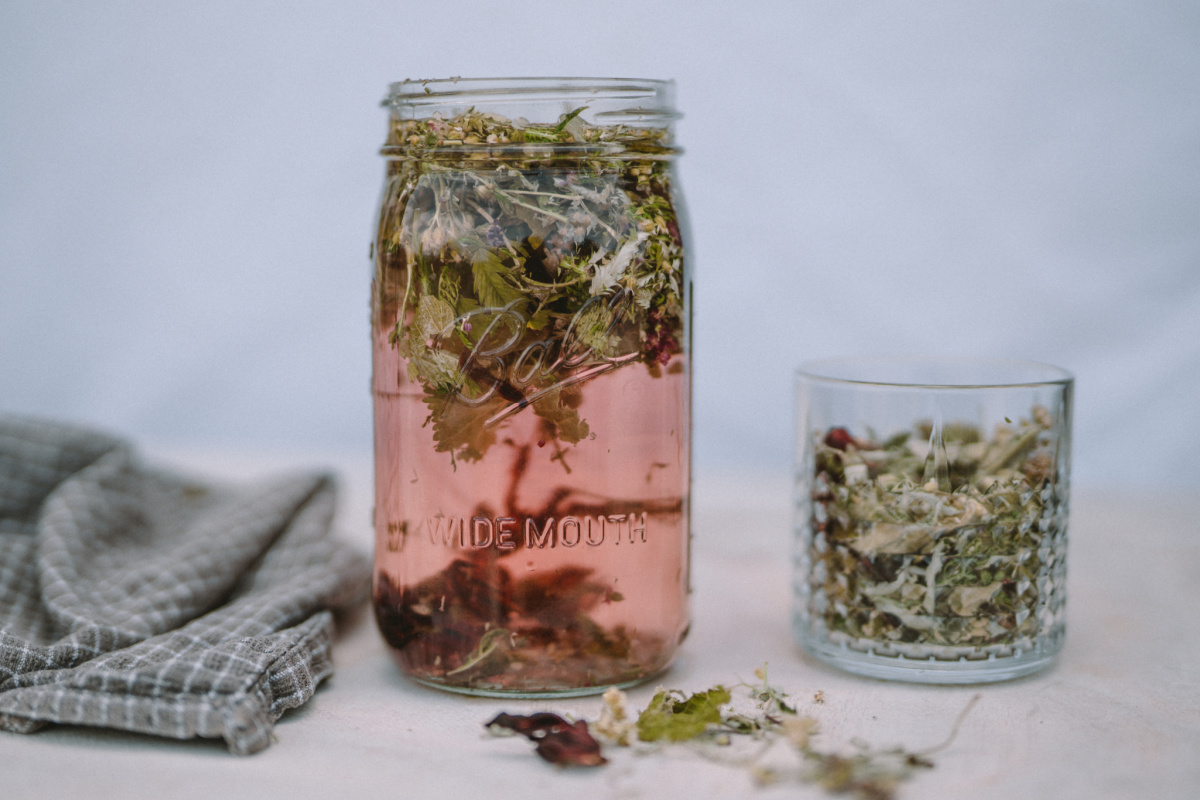 herbs infusing in a jar to make Moon Cycle Tea