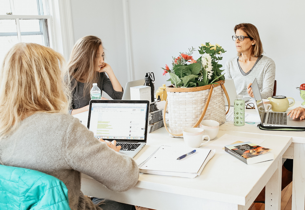Herbal Academy team members talking around a table
