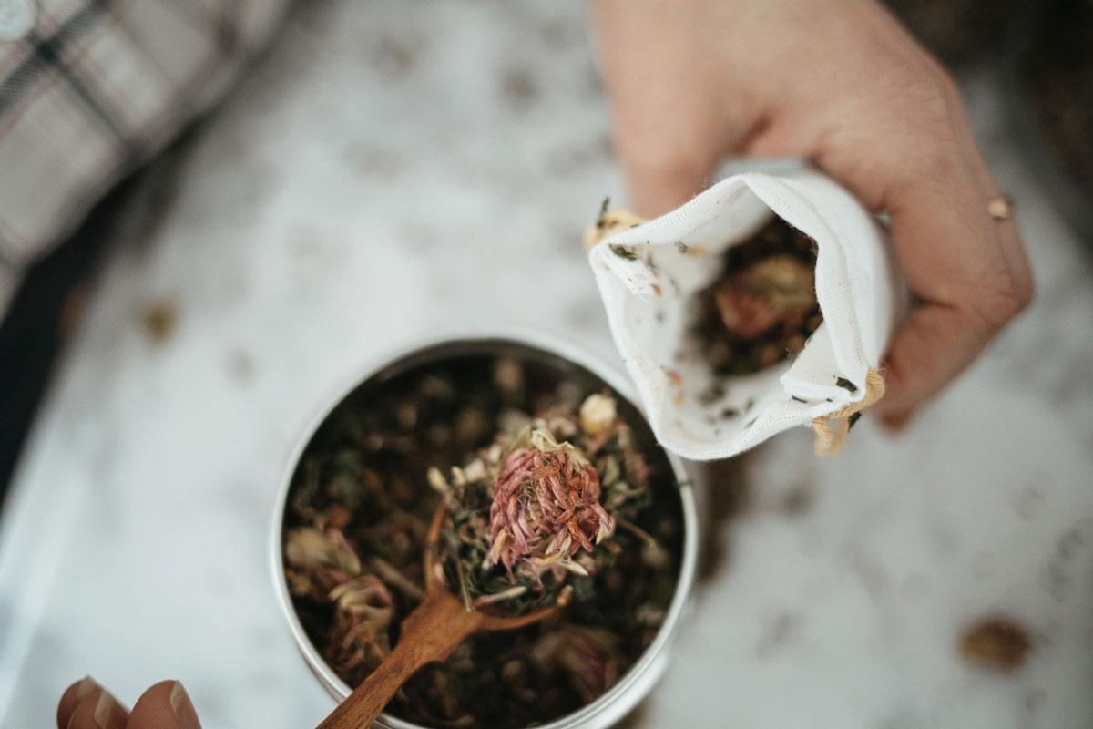 placing herbal tea into tea bag
