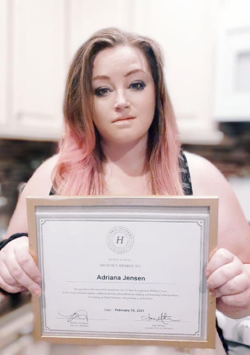 Adriana Jensen holding Herbal Academy certificate