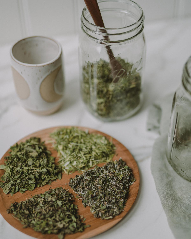 herbs for pregnancy tea in jar and on wodden platter