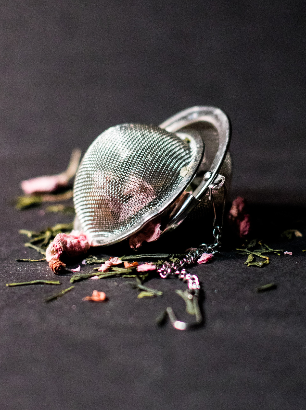 tea ball with dried herbs spilling out