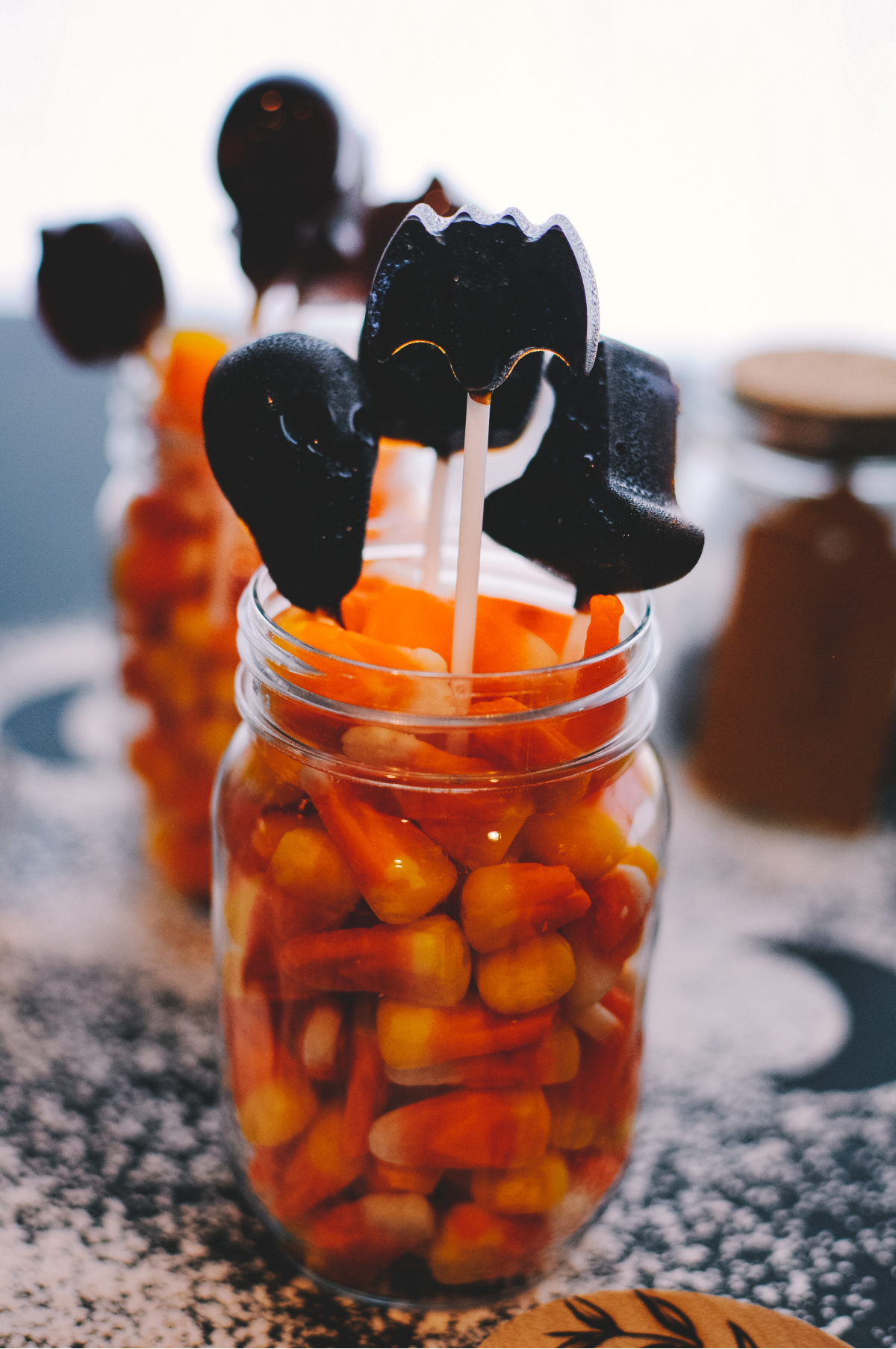 herbal lollipops in a jar with candy corn