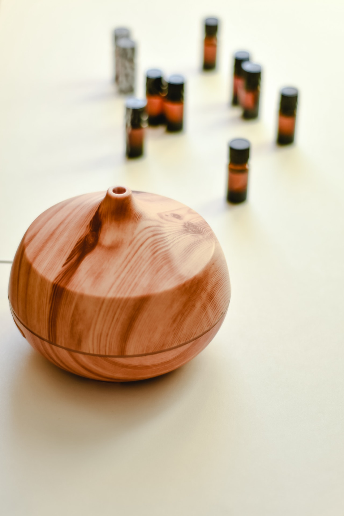 diffuser with essential oils in the background
